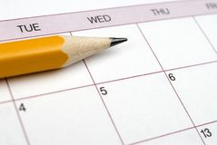 paper calendar with a pencil sitting on it